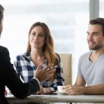couple consulting a mortgage broker about shopping for a home loan