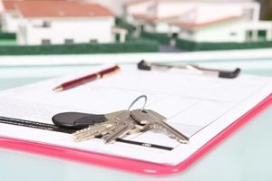 House Keys on Adjustable Rate Mortgage Paperwork at a House Closing