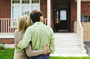 Young couple excited about their home refinancing options