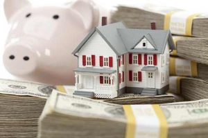 Piggy bank, house and mortgage down payment
