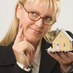 Woman Wondering If Her Credit Score is Good Enough For an FHA Loan