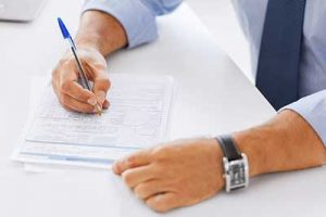 Man signing house closing documents