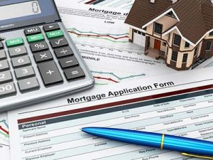 image representing mortgage options with a mortgage application form with a calculator and house