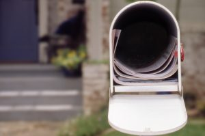 head on view of open mailbox containing a STAR refund check