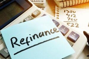 Refinance written on a memo stick and calculator